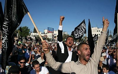 Supporters of Hizb ut-Tahrir demonstrate in Ramallah,  July 7, 2012 (photo credit: Issam Rimawi/Flash90)