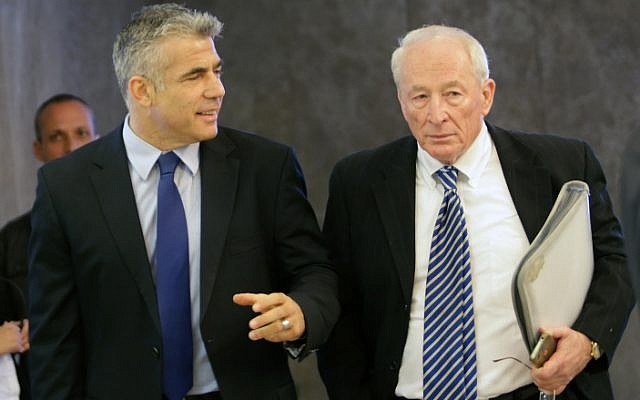Finance Minister Yair Lapid and Attorney General Yehuda Weinstein attend a cabinet meeting in April 2013. Weinstein said that the government couldn't support a key part of Lapid's new housing bill (photo credit: Alex Kolomoisky/POOL/FLASH90)