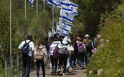 Israeli youth walk on the road connecting Yad Vashem to Mount Herzl in Jerusalem, ahead of the annual Memorial Day for Fallen Soldiers, April 10, 2013 (photo credit: Flash90)