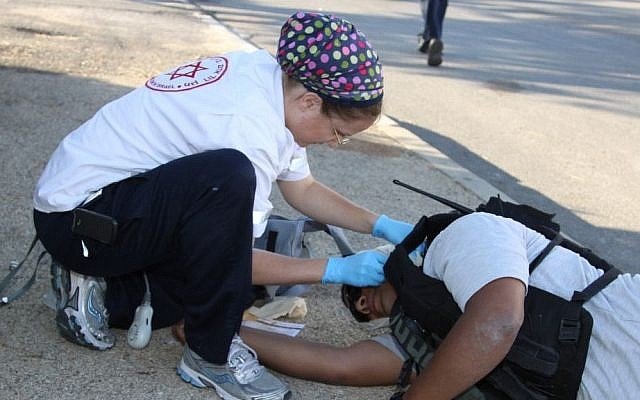 A Magen David Adom worker simulates treating a wounded Palestinian terrorist during a security drill in the settlement of Efrat, June 29, 2013 (photo credit: Flash90/Gershon Elinson)