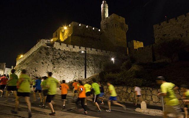 Illustrative: Runners participating in Jerusalem's 10k November 2014 night run. (Flash 90)