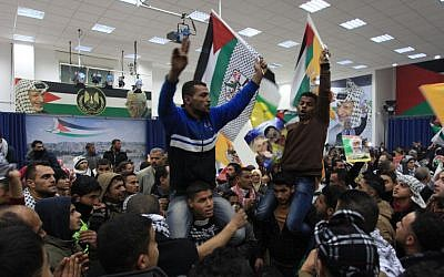 Palestinians celebrate the third installment of the prisoner release by Israel at the presidential compound in Ramallah, December 31, 2013. (photo credit: Issam Rimawi/Flash90)