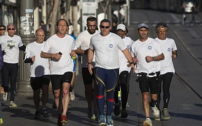 Jerusalem Mayor Nir Barkat, a longtime runner, preparing for the 2014 Jerusalem marathon (photo credit: Yonatan Sindel/Flash 90)