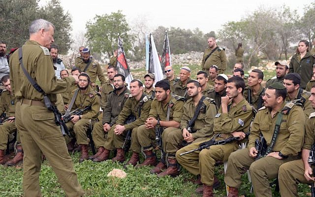 IDF Chief of Staff Benny Gantz speaks with soldiers during a visit to the Netzah Yehuda Battalion near Jenin, on Sunday, March 2, 2014. (photo credit: IDF Spokesperson/Flash90)