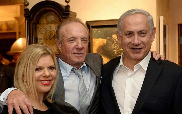 Prime Minister Benjamin Netanyahu and his wife Sara with Hollywood actor James Caan, seen at an event held at the home of producer Arnon Milchan. (photo credit: Avi Ohayon/GPO/Flash90)