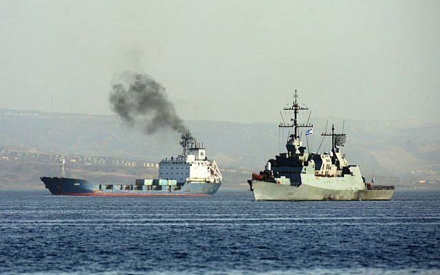 An Israeli Navy boat escorts the cargo vessel Klos C (left) into the Israeli port of Eilat on Saturday (Photo credit: Flash90)