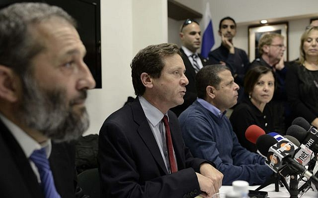 Labor leader Isaac Herzog, center, speaking to the press in the Knesset alongside Shas leader Aryeh Deri, left, and Meretz leader Zahava Gal-on, seated far-right, March 10, 2014. (Tomer Neuberg/Flash90)