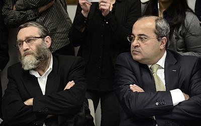 Friends for a day? Israeli-Arab MK Ahmed Tibi (R) sits next to United Torah Judaism's Moshe Gafni (L) at a meeting of the Knesset opposition (Photo credit: Tomer Neuberg/Flash90)