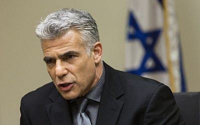 Minister of Finance and Chairman of Yesh Atid party, Yair Lapid, seen during the Yesh Atid Faction meeting at the Knesset on Monday, March 10, 2014. (photo credit: Flash90)