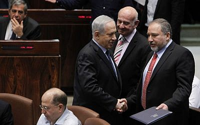 Foreign Minister Avigdor Liberman with Prime Minister Benjamin Netanyahu in the Knesset as it votes on the Governance Bill, March 11, 2014. (photo credit: Miriam Alster/FLASH90)