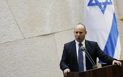 Economics and Trade Minister Naftali Bennett addresses the Knesset plenum, March 2014. (photo credit: Miriam Alster/Flash90)