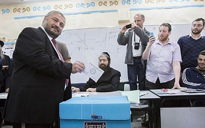 Bet Shemesh mayoral candidate Moshe Abutbul casts his vote at a polling station, during the second round of the local elections in the city, March 11, 2014. (Yonatan Sindel/Flash90)