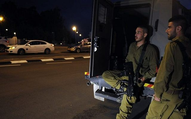 IDF soldiers in the southern city of Sderot on Wednesday night, March 12, 2014 (Photo credit: Flash90)