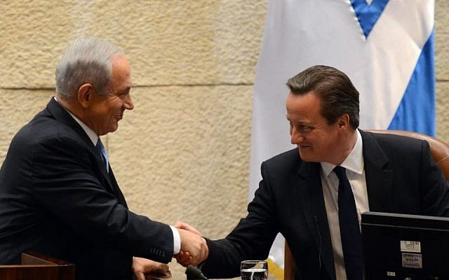 Prime Minister Benjamin Netanyahu shakes hands with British Prime Minister David Cameron in the Knesset, March 12, 2014. (Photo credit: Haim Zach/GPO/Flash 90)