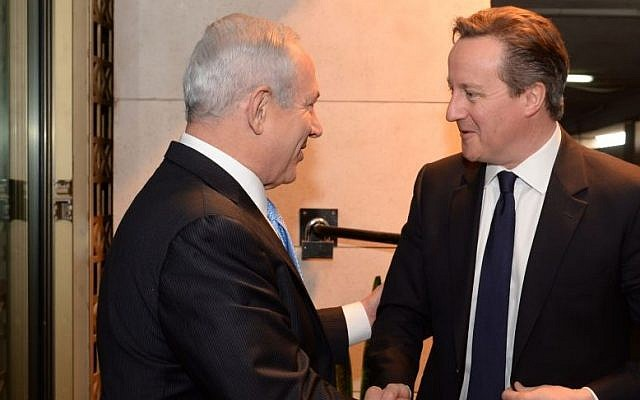 Prime Minister Benjamin Netanyahu (left) meets with British Prime Minister David Cameron (right) in Jerusalem, March 12, 2014. (Kobi Gideon/GPO/Flash90)