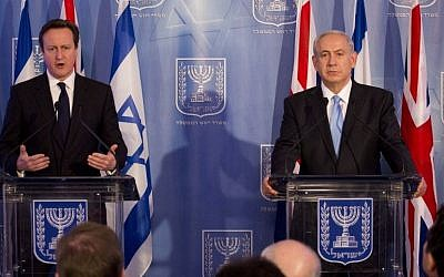 Prime Minister Benjamin Netanyahu (R) and his British counterpart David Cameron at a joint press conference in Jerusalem on March 12 2014. (Photo credit: Tali Mayer/POOL/Flash90)
