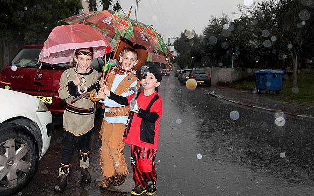 Israeli children wear costumes as they celebrate the upcoming Jewish holiday of Purim in Tel Aviv on March 13, 2014. (photo credit: Gideon Markowicz/Flash90)