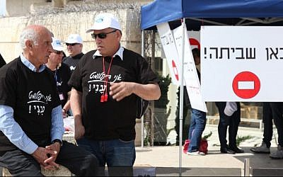 Foreign Ministry workers protest outside the ministry's offices in Jerusalem on March 24, 2014.  The sign reads 'Here there is a strike.' (Meital Cohen/Flash90)
