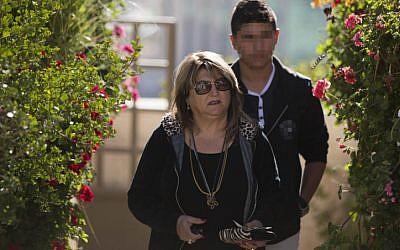 Shula Zaken, Ehud Olmert's bureau chief, leaves her home in Jerusalem on March 27, 2014. (photo credit: Yonatan Sindel/Flash90)