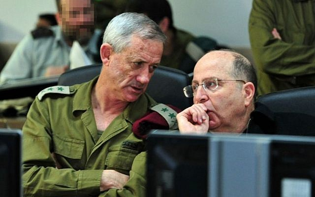 IDF Chief of Staff Benny Gantz confers with Defense Minister Moshe Ya'alon at the Navy war room during Wednesday morning's operation by naval commandos  during which they captured a Iranian shipment of weapons on its way to Gaza (photo credit: Ariel Hermoni/ Ministry of Defense)