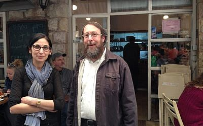 Merav Mizrachi and Rabbi Aaron Leibowitz outside Cafe Mizrachi, in Mahane Yehuda (photo credit: Jessica Steinberg/Times of Israel)
