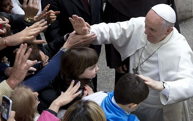 Pope Francis greets faithful as he arrives for a meeting with relatives of innocent mafia victims, in Rome's St. Gregorio VII church, just outside the Vatican, Friday, March 21, 2014. (photo credit: AP Photo/Andrew Medichini)