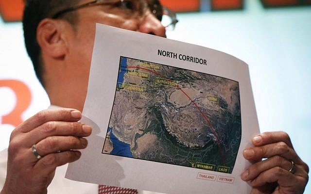 Malaysia's acting Transport Minister Hishamuddin Hussein shows the map of the northern search area during a press conference at a hotel next to the Kuala Lumpur International Airport, in Sepang, Malaysia, on Monday, March 17, 2014. (photo credit: AP Photo/Vincent Thian)