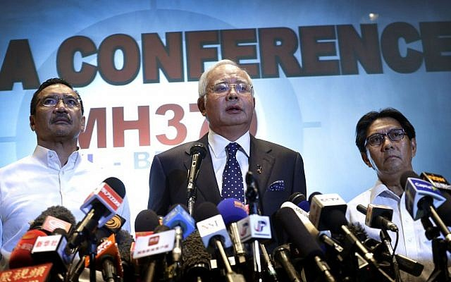 Malaysian Prime Minister Najib Razak, center, Malaysia's Minister for Transport Hishamuddin Hussein, left, and director general of the Malaysian Department of Civil Aviation, Azharuddin Abdul Rahman, speakto the media regarding the missing Malaysia Airlines jetliner MH370, Saturday, March 15, 2014. (photo credit: AP Photo/Wong Maye-E)