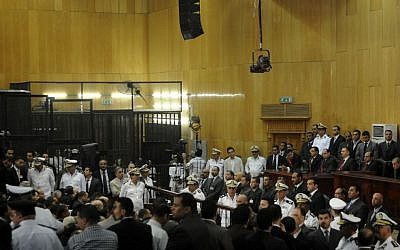 In this Saturday, June 2, 2012 file photo, people gather inside a courtroom to hear a verdict in the trial of former Egyptian President Hosni Mubarak, his sons and several security officers in Cairo, Egypt, Saturday, June 2, 2012. (photo credit: AP/File)