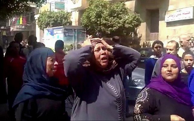 Image from video shows relatives reacting after an Egyptian court on Monday sentenced to death 529 supporters of ousted Islamist President Mohammed Morsi, Egypt, Monday, March 24, 2014. (photo credit: AP, via AP video)