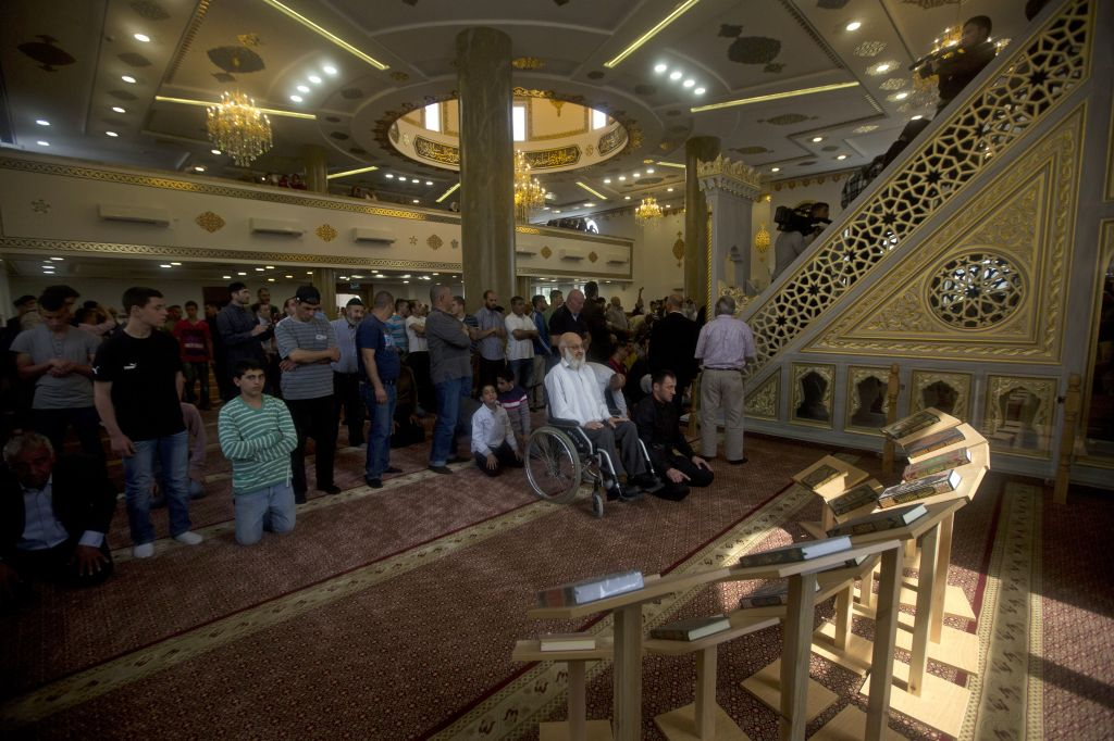 People pray in a new mosque, partially funded by Chechnya, in the Arab village of Abu Ghosh, on the outskirts of Jerusalem, Sunday, March 23, 2014. (photo credit: AP/Sebastian Scheiner)