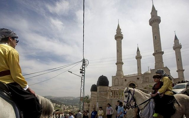 People ride horses near the new mosque, partially funded by Chechnya, in the Arab town of Abu Ghosh, near Jerusalem, March 23, 2014. (AP/Sebastian Scheiner)