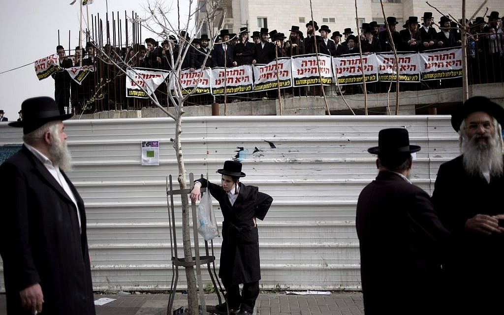 Ultra-Orthodox Israelis gather for a rally in Jerusalem, Sunday, March 2, 2014 (photo credit: AP/Ariel Schalit)
