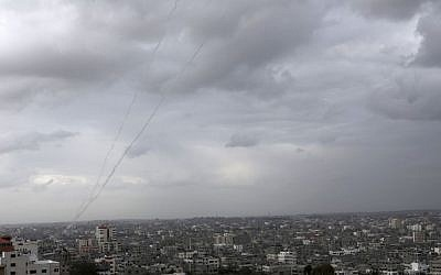 A trail of smoke from rockets fired by Palestinians from Gaza toward Israel is seen above Gaza City on Wednesday, March 12, 2014. (photo credit: AP/Adel Hana)