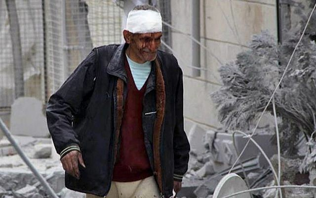 The aftermath of an airstrike in Aleppo, Syria, on  Tuesday, March 18, 2014. (photo credit: AP Photo/Aleppo Media Center, AMC)
