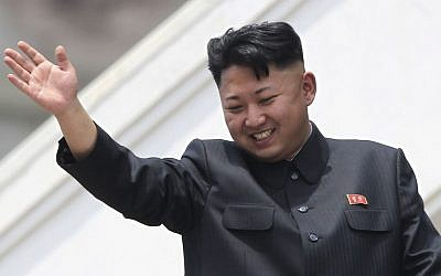 North Korean leader Kim Jong Un waves during a mass military parade, July 27, 2013. (photo credit: AP/Wong Maye-E)