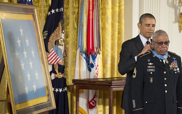 US President Barack Obama awards Army Staff Sgt. Melvin Morris the Medal of Honor during a ceremony in the East Room of the White House in Washington, on Tuesday (photo credit: AP/Manuel Balce Ceneta)