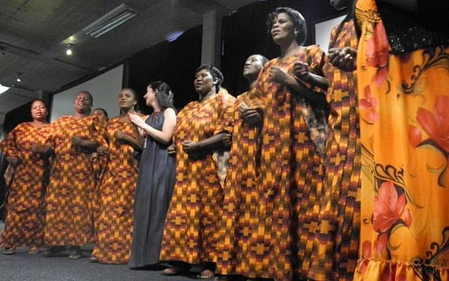 Dr. Daniella Mark (center) sings with the Desmond Tutu HIV Foundation Sizophila Singers, a choir of HIV counsellors from Gugulethu, Cape Town. Counsellors play a vital role in supporting those living with HIV. (courtesy PATA)
