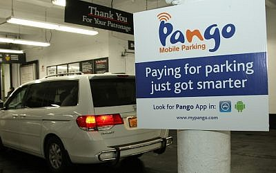 A sign in a New York City parking garage welcoming Pango payments (Courtesy)
