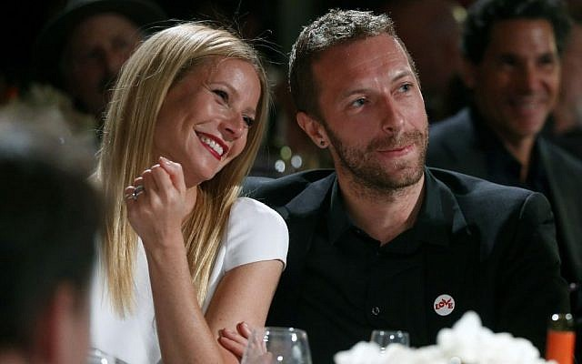 This Jan. 11, 2014 file photo shows actress Gwyneth Paltrow, left, and her husband, singer Chris Martin at the 3rd Annual Sean Penn & Friends Help Haiti Home Gala in Beverly Hills, Calif. Paltrow and Martin are separating after 11 years of marriage. (Photo credit: Colin Young-Wolff /Invision/AP, File)