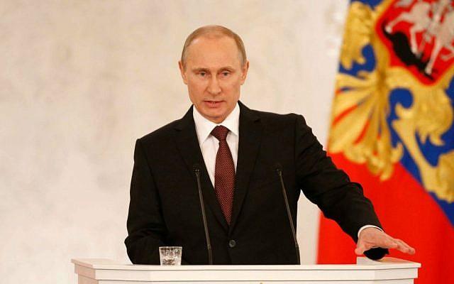 Russian President Vladimir Putin addresses the Federation Council in Moscow's Kremlin on Tuesday, March 18, 2014. (photo credit: AP/Alexander Zemlianichenko)