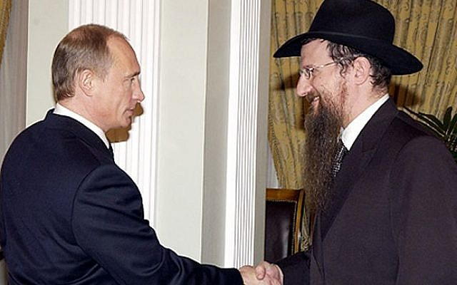 Russian President Vladimir Putin, left, meeting with the Chief Rabbi of Russia Berel Lazar, March 2005. (photo credit: Kremlin/JTA)