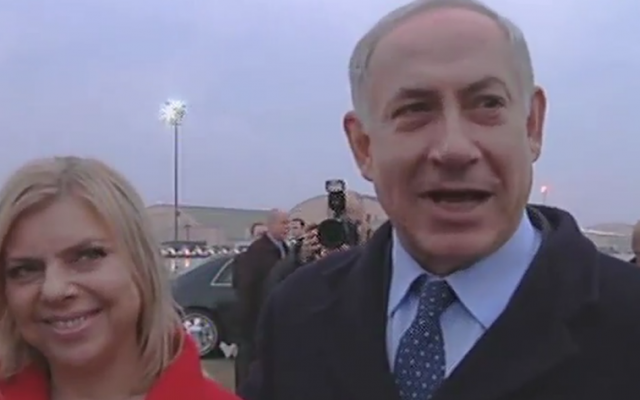 Prime Minister Benjamin Netanyahu, wife Sara at his side, responds to President Barack Obama's criticism on his arrival in the US, March 3, 2014 (photo credit: Channel 2 screenshot)