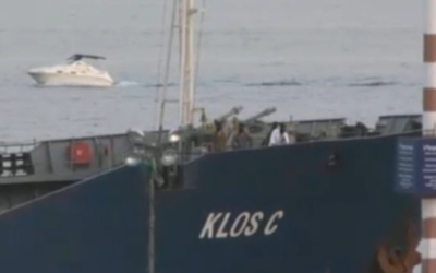 Masked Shayetet 13 soldiers standing on the bow of the Klos-C as it docks in Eilat on Saturday, March 8, 2014. (screen capture: Ynet)
