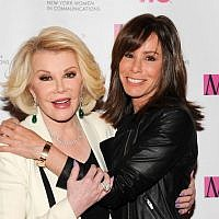 Joan Rivers (left), and daughter Melissa Rivers at the 2013 Matrix New York Women in Communications Awards, in New York, April 22, 2013. (AP/Evan Agostini/Invision)