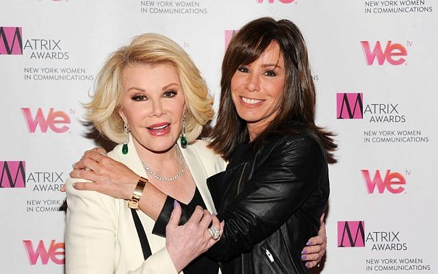 Joan Rivers (left), and daughter Melissa Rivers at the 2013 Matrix New York Women in Communications Awards, in New York, April 22, 2013. (photo credit: AP/Evan Agostini/Invision)