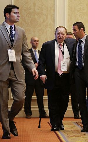 Sheldon Adelson, center, arrives at the Republican Jewish Coalition as New Jersey Gov. Chris Christie speaks, Saturday, March 29, 2014, in Las Vegas (photo credit: AP/Julie Jacobson)