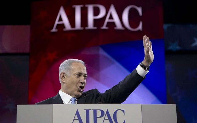 Prime Minister Benjamin Netanyahu waves to the cheering audience as he arrives to speak to the AIPAC meeting at the Washington Convention Center, Tuesday, March 4, 2014, in Washington. (photo credit: AP/Carolyn Kaster)