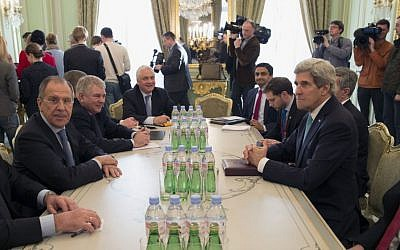 Secretary of State John Kerry, right, and Russian Foreign Minister Sergei Lavrov meet at the Russian Ambassador's Residence in Paris, Wednesday, March 5, 2014. (photo credit: AP/Kevin Lamarque, Pool)