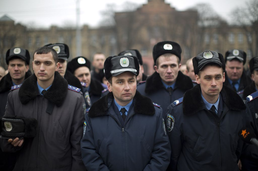 Ukrainian police officers attend a rally to pay their respects for people killed during the latest clashes at the Independence Square in Kiev, Ukraine, Saturday, March 1, 2014 (photo credit: AP/Emilio Morenatti)